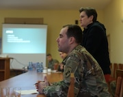 418th Civil Affairs Soldiers meet with local leaders in Zagan, Poland