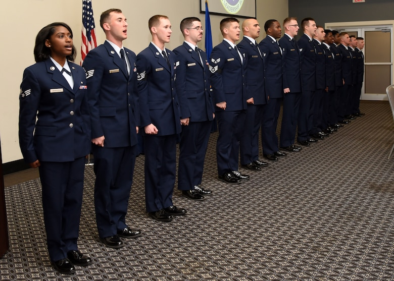 U.S. Air Force Airman Leadership School graduates sing the Air Force song during the ALS Graduation Ceremony in the event center at Goodfellow Air Force Base, Texas, Feb. 13, 2020.  The graduates charge the attendees to join in with singing, in recognition to Air Force heritage and honor. (U.S. Air Force photo by Airman 1st Class Abbey Rieves)