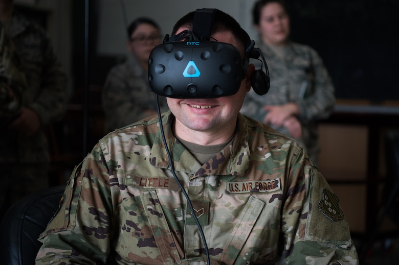 U.S. Senior Airman Joshua Little, 1st Operations Support Squadron intel analyst, use a virtual reality system brought to Joint Base Langley-Eustis, Virginia, by Airmen from the 547th Intelligence Squadron, Nellis Air Force Base, Nevada, Feb. 12, 2020.
