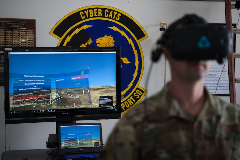 A U.S. Air Force Airman uses a virtual reality system brought to Joint Base Langley-Eustis, Virginia, by Airmen from the 547th Intelligence Squadron, Nellis Air Force Base, Nevada, Feb. 12, 2020.