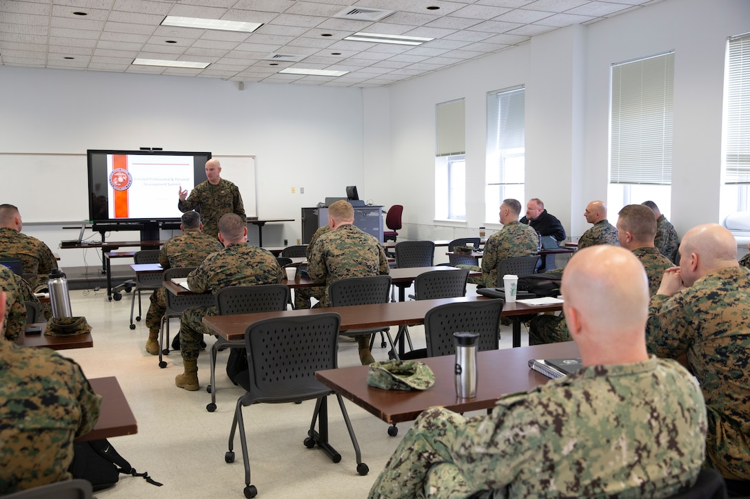 U.S. Marine Corps Sgt. Maj. Troy E. Black, Sergeant Major of the Marine Corps, addresses a summit on enlisted professional and personal development efforts at Marine Corps Base Quantico, V.A., Feb. 3.