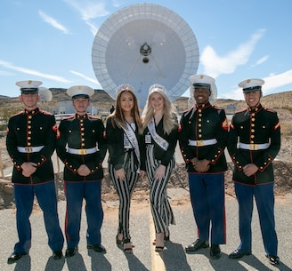 MCLB Barstow's walking color guard pose with Miss Barstow, Alex Duarte, and Miss Teen Barstow, Joslin Crank, during a groundbreaking ceremony held at the Goldstone Deep Space Communications Complex, Ft. Irwin, Feb. 11.
