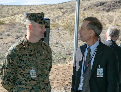 Col. Craig C. Clemans, commander, MCLB Barstow, speaks with retired Air Force Lt. Gen. Larry James, during a groundbreaking ceremony at the NASA/JPL Goldstone Deep Space Communications Complex aboard the National Training Center at Ft. Irwin, Feb. 11.