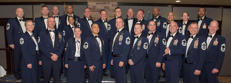 Recently inducted and current Team Holloman Chief Master Sergeants pose for a photo during the Chief Recognition Ceremony, Feb. 15, 2020, on Holloman Air Force Base, N.M. Eight individuals from Team Holloman were recognized during the formal ceremony and dinner. (U.S. Air Force photo by Staff Sgt. Christine Groening)