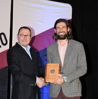 Left to right, CEO of Running USA, Rich Harshbarger, presents Air Force Marathon director, Brandon Hough, the Rising Star award at the Running USA Industry Conference in Las Vegas, Feb. 9, 2020. (Courtesy photo)