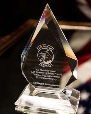 A stylized photo of the 2019 Air National Guard, Director of Safety Award for Outstanding Achievement in Occupational Safety. The award is crystal with the title of the award, etched on the surface.