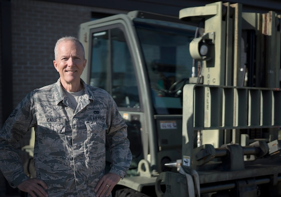 Staff Sgt. Jim Cagle, air terminal operations center controller in the 41st Aerial Port Squadron at Keesler Air Force Base, Miss., poses for a photo in front of a forklift at Keesler Feb. 8, 2020. Prior to his five years with the 403rd Wing, Cagle served as a weapons system officer and fighter pilot in the Louisiana Air National Guard from 1980 to 1993. (U.S. Air Force photo by Senior Airman Kristen Pittman)