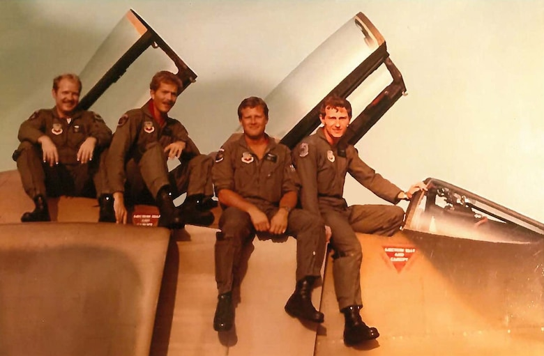 Staff Sgt. Jim Cagle, second from left, poses for a photo on a  F-4C Phantom at an undisclosed location. 26 years after separating from service at the rank of captain. Cagle rejoined as enlisted member with the 403rd Wing at Keesler Air Force Base, Miss. (U.S. Air Force courtesy photo)