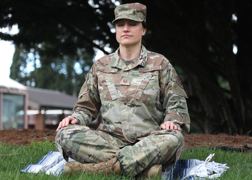 U.S. Air Force Master Sgt. Kathleen A. Myhre, 446th Airman and Family Readiness Center noncommissioned officer in charge, meditates outside the 446th Airlift Wing Headquarters building on Joint Base Lewis-McChord, Washington, Feb. 12, 2020.