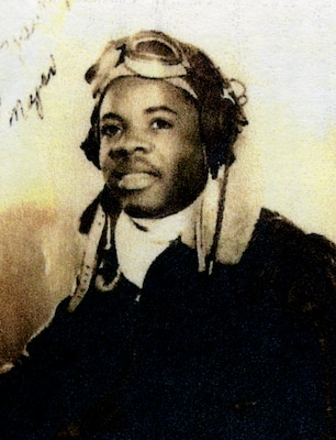 Black teenager posing with aviator goggles in 1943