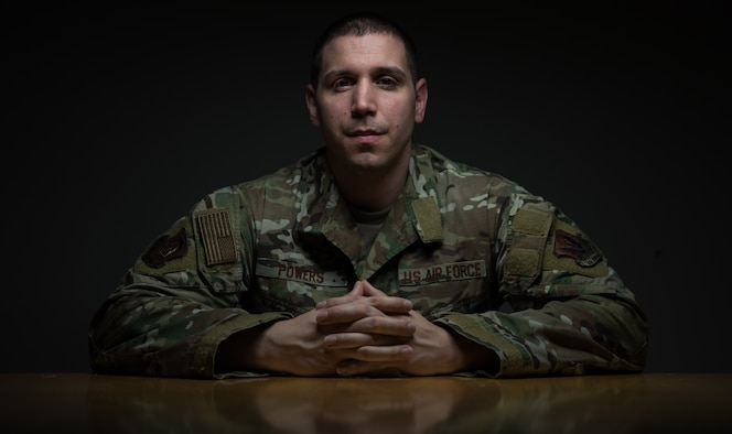 U.S. Air Force Master Sgt. Ryan Powers, 633rd Medical Group internal medicine non-commissioned officer in-charge, sits at a table at Joint Base Langley-Eustis, Virginia, Feb. 13, 2019. Powers was injured during a deployment and is now a Wounded Warrior. (U.S. Air Force photo by Airman 1st Class Sarah Dowe)
