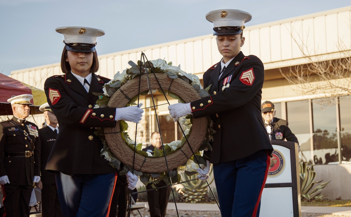 Sgt. Alejandra Cabrera, left, and Sgt. Mariela Quiles, both administrative specialists from Headquarters and Support Battalion, Marine Corps Installations-West, carry the wreath at the 75th Commemoration of the Battle of Iwo Jima ceremony at Marine Corps Base Camp Pendleton, California, Feb. 15.