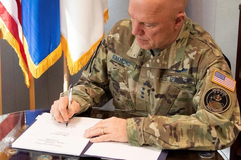 Gen Raymond SATCOM Agree Signing