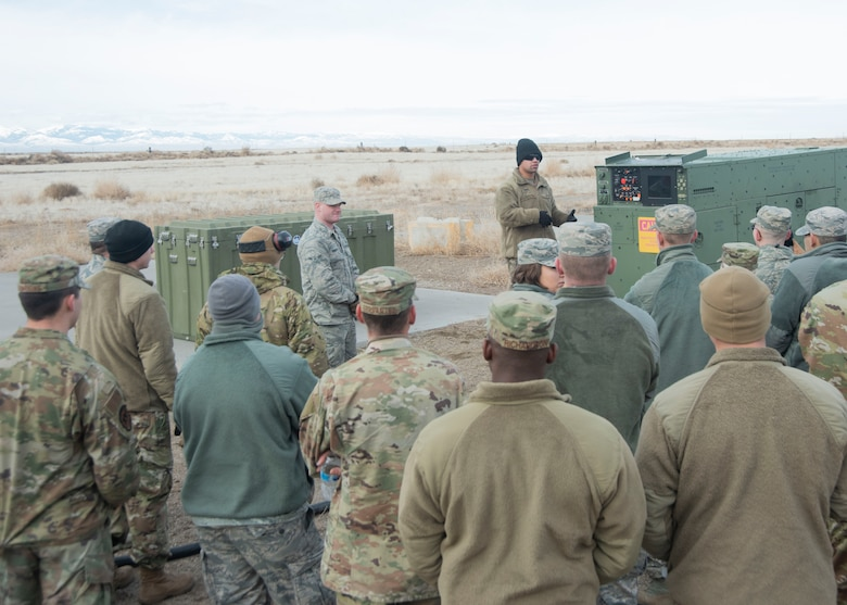 U.S. Air Force Staff Sgt. Kevin Rivera Calzada, 366th Civil Engineering Squadron power production journeyman, briefs the trainees of the Base Emergency Engineer Force the components of the generator, Jan. 23, 2020, on Mountain Home Air Force Base, Idaho. The briefing prepares the trainees on what to do if the members of the power production crew are not available. (U.S. Air Force photo by Airman 1st Class Akeem K. Campbell)