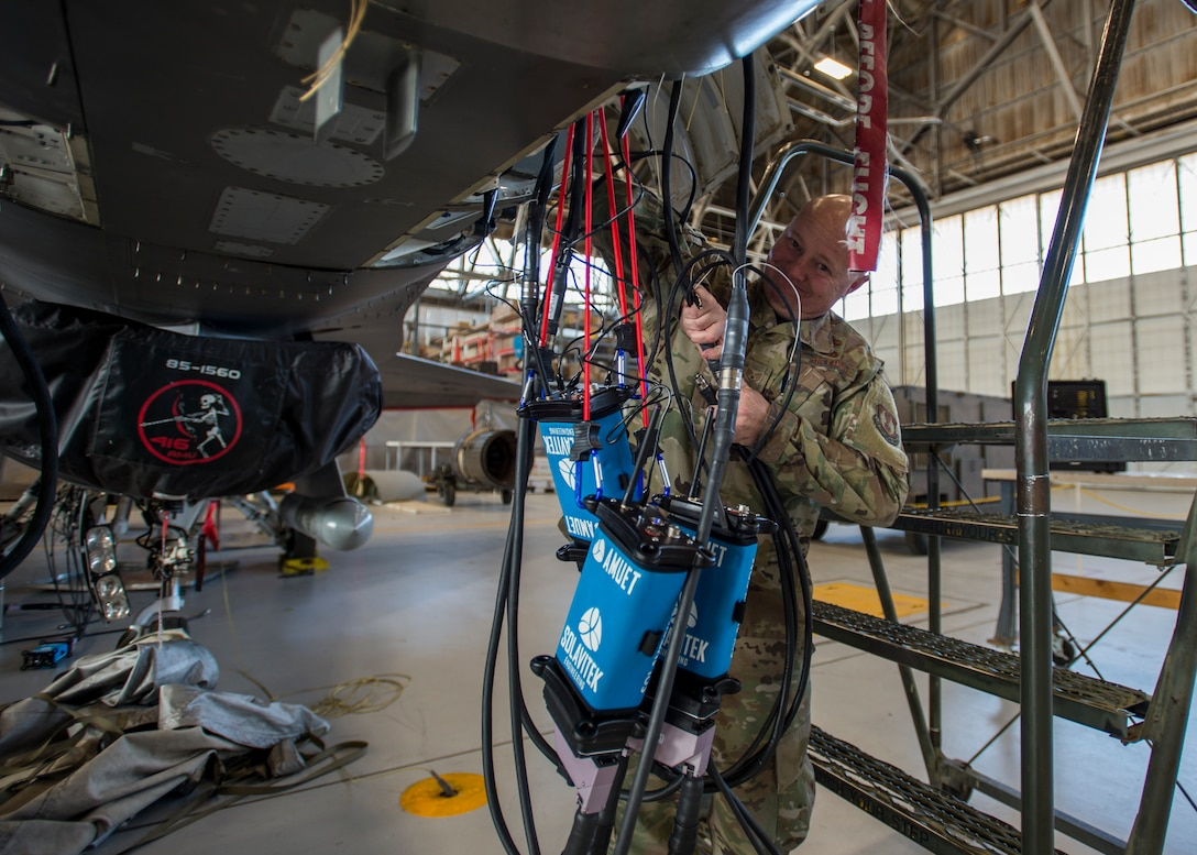 Staff Sgt. Jocko Hammond, 412th Aircraft Maintenance Squadron, attaches a wire bundle to an Advanced Mobile Universal Electrical Tester, or AMUET, at Edwards Air Force Base, California, Feb. 4. (Photo by Giancarlo Casem)