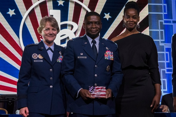 Col. Terrance A. Adams, commander of the 628th Air Base Wing and Joint Base Charleston, S.C., along with his sister, Felicia Johnson, accepted the Military Service Award from Gen. Maryanne Miller, Air Mobility Command commander, at the 2020 Black Engineer of the Year Stars and Stripes dinner, Feb. 14, 2020, Washington, D.C. Adams earned the award for his more than 14 years of service to BEYA and over 5,000 students reached. (U.S. Air Force photo by Staff Sgt. James Richardson)