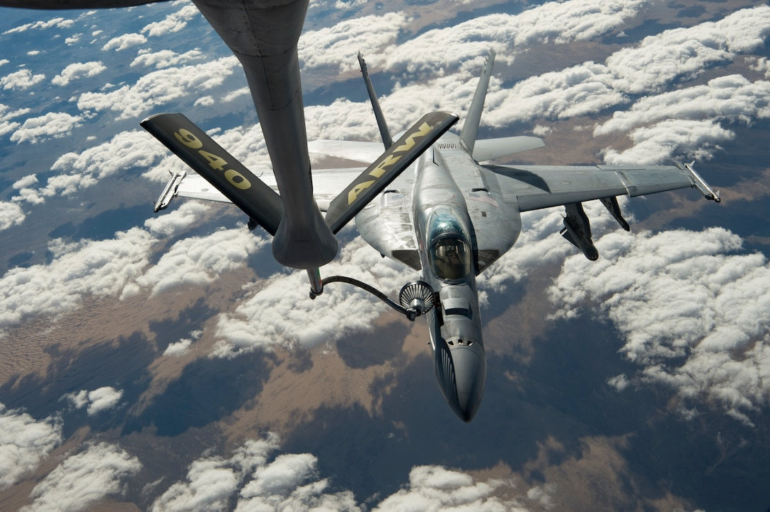 A U.S. Navy F/A-18 Super Hornet receives fuel from a KC-135 Stratotanker assigned to the 28th Expeditionary Air Refueling Squadron over Afghanistan, Jan. 14, 2020. The 28th EARS, deployed with U.S. Air Forces Central Command, is responsible for delivering fuel to U.S. and coalition forces, enabling a constant presence in the area of responsibility. (U.S. Air Force photo by Staff Sgt. Bethany E. La Ville)