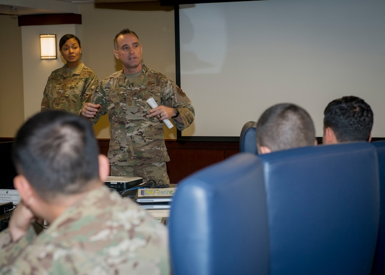 Photo of Chief Master Sgt. Daniel Hoglund, AFPC's command chief speaking to squadron leaders in the Boles Conference room at Joint Base San Antonio-Randolph, Texas.