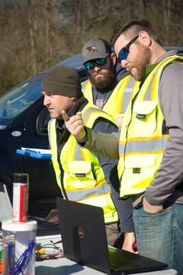 The U.S. Army Engineer Research and Development Center-Environmental Laboratory's Unmanned Aircraft Systems team members Barry Barnett, Kenneth Matheson and Shea Hammond watch the Vapor 55, a UAS that weighs just under 55 pounds and carries both the LiDAR sensor and 42MP camera, as it follows its flight path around the installation.