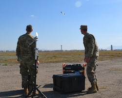 First Lt. Adam Treece, 56th Operations Support Squadron intelligence readiness chief, and Capt. David Coyle, 56th OSS weapons officer, showcase a prototype threat emitter system Jan. 17, 2020, at Luke Air Force Base, Ariz.