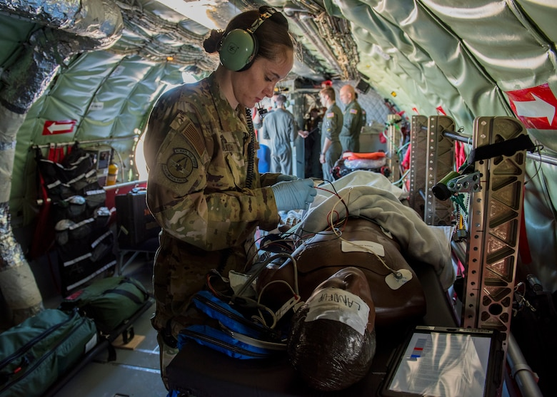 U.S. Air Force 1st Lt. Elayne Smith, 43rd Aeromedical Evacuation Squadron flight nurse, places electrocardiogram leads onto a training mannequin during an aeromedical evacuation training mission at Travis Air Force Base, California, Feb. 11, 2020. The 43rd AES is currently transitioning from its present station at Pope Army Airfield, North Carolina, to become part of the 60th AES at Travis Air Force Base, California, providing more training opportunities on the KC-10 Extender, C-5 Super Galaxy and C-17 Globemaster III based there, as well as KC-135s based out of Fairchild. (U.S. Air Force photo by Senior Airman Lawrence Sena)