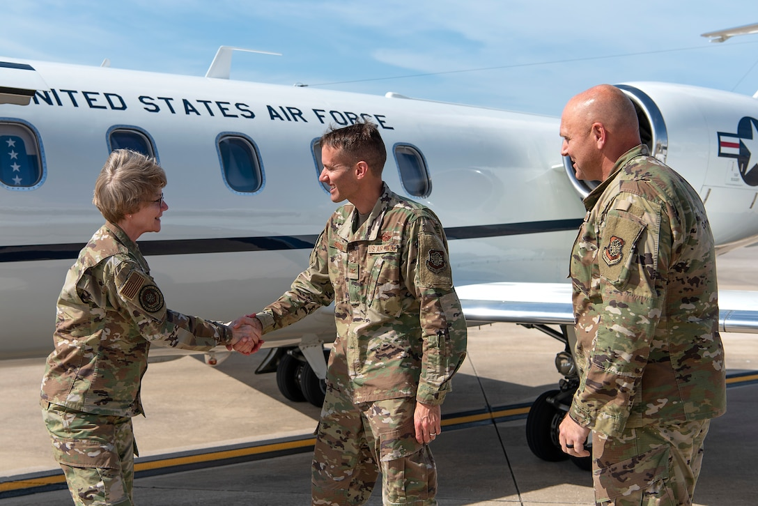 U.S. Air Force Gen. Maryanne Miller, Air Mobility Command commander, greets Col. Steve Snelson, 6th Air Refueling Wing commander, and Chief Master Sgt. Anthony Green, 6th ARW command chief, at MacDill Air Force Base, Fla., Feb. 12, 2019. Miller visited MacDill and toured various squadrons around the base Feb. 12-14, 2020.