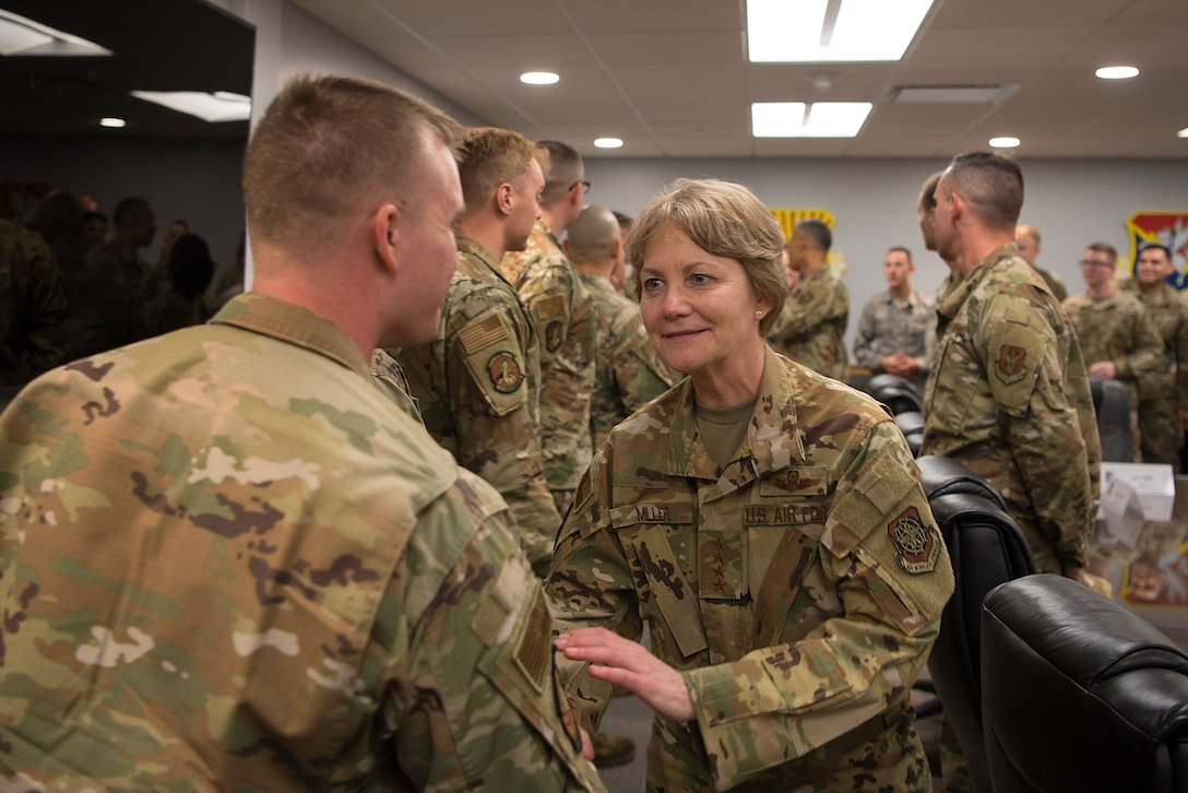 U.S. Air Force Gen. Maryanne Miller, Air Mobility Command commander, greets a 6th Air Refueling Wing Airman at MacDill Air Force Base, Fla., Feb. 13, 2020. During her visit, Miller met with aircraft maintenance Airmen and listened to their questions and concerns.