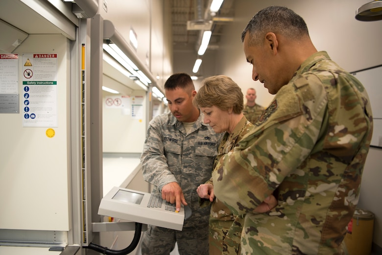 """U.S. Air Force Gen. Maryanne Miller, Air Mobility Command commander, and Chief Master Sgt. Terrence Greene, AMC command chief, are shown the new vertical lift storage system at MacDill Air Force Base, Fla., Feb. 13, 2020. This streamline tool kit system was recently implemented as part of the wing's """"Fuel Tank"""" program, which gives Airmen the opportunity to present innovative ideas to leadership."""