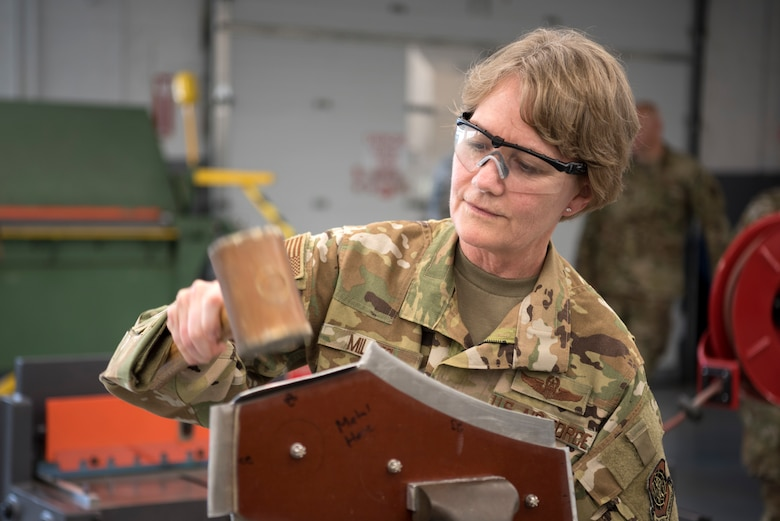 U.S. Air Force Gen. Maryanne Miller, Air Mobility Command commander, molds a piece of metal during a visit to the fabrication flight at MacDill Air Force Base, Fla., Feb. 13, 2020. Miller visited MacDill and toured various squadrons around the base Feb. 12-14, 2020.