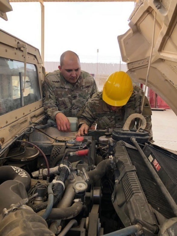 Sgt. 1st Class Joshua Watson, maintenance management noncommissioned officer in charge (NCOIC), Area Support Group – Qatar (ASG-QA), works with another ASG-QA Soldier to conduct a maintenance inspection at Camp As Sayliyah, Qatar, Feb. 18, 2020. (Courtesy photo)