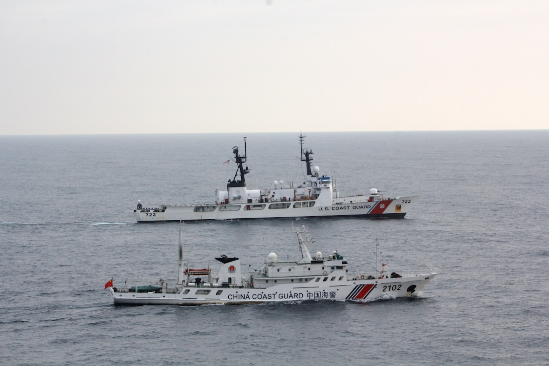 The Coast Guard Cutter Morgenthau and China coast guard vessel 2102 steam alongside each other during the transfer of the fishing vessel Yin Yuan in the North Pacific Ocean June 3, 2014. The Morgenthau crew was patrolling in support of Operation North Pacific Guard, the Coast Guard's component of a multi-lateral fisheries law enforcement operation designed to detect and deter illegal, unreported and unregulated fishing activity. (U.S. Coast Guard photo by Coast Guard Cutter Morgenthau)