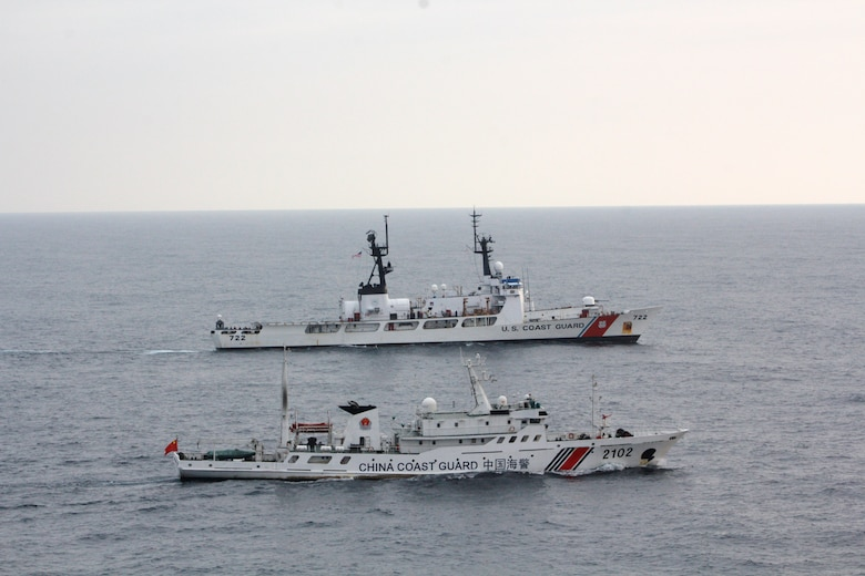 The Coast Guard Cutter Morgenthau and China coast guard vessel 2102 steam alongside each other during the transfer of the fishing vessel Yin Yuan in the North Pacific Ocean June 3, 2014.