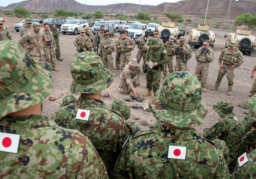 US Army 1LT Nicholas Sereday, executive officer for Charlie Company 2-113th Infantry assigned to Combined Joint Task Force-Horn of Africa, gives a concept of operations brief to Japanese and US military forces during a bilateral field training exercise in Djibouti, Africa, 2 October 2019.