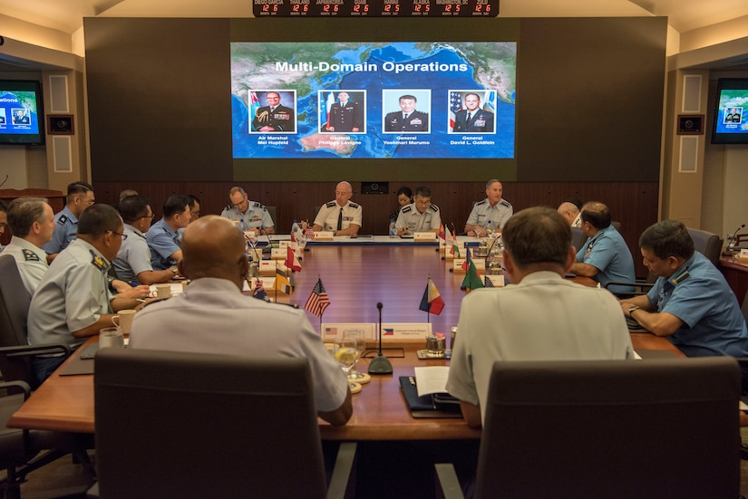 Air Marshal Mel Hupfeld, chief, Royal Australian Air Force; Gen Philippe Lavigne, chief of staff, French Air Force; Gen Yoshinari Marumo, chief, Japan Air Self-Defense Force; and Gen David L. Goldfein, chief of staff, US Air Force participate in a multi-domain operations panel during the 2019 Pacific Air Chiefs Symposium (PACS) at Joint Base Pearl Harbor–Hickam, Hawaii, 5 December 2019.