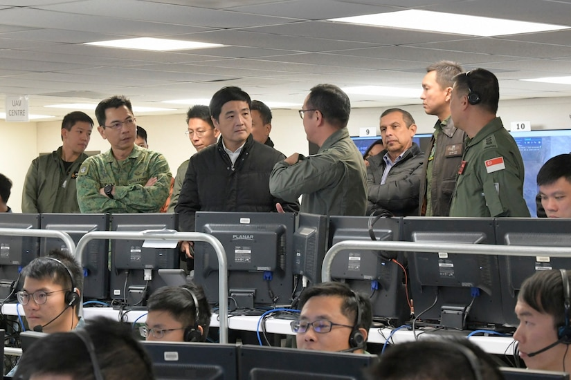 Singapore's Senior Minister of State for Defence Heng Chee How receives a brief on the capabilities of the command post at Exercise Forging Sabre 2019, hosted at Mountain Home AFB, Idaho.