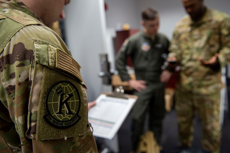 Photo of an Airman issuing another Airman equipment.