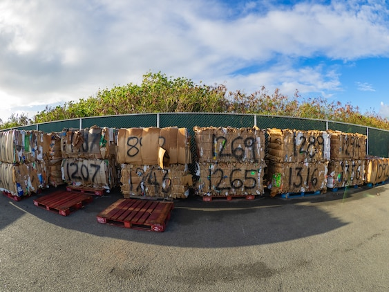 Cardboard bales after staff have sorted and prepared it for shipping.