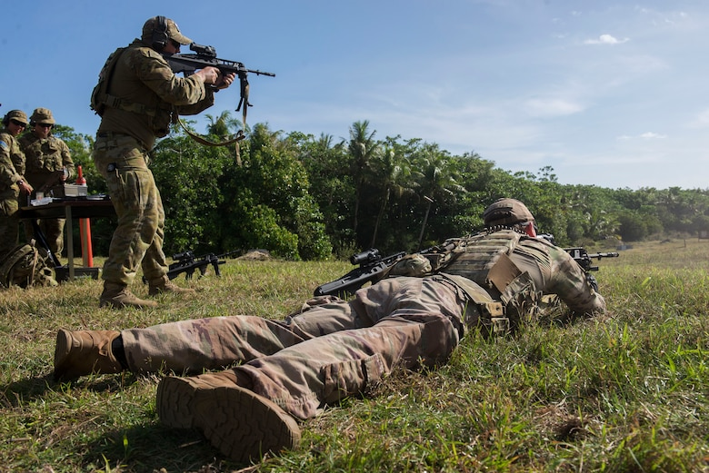 U.S. Air Force and Royal Australian Air Force (RAAF) personnel practice shooting the U.S. Air Force M4 assault rifle during Pacific Defender 20-1 at Andersen Air Force Base, Guam, Feb. 12, 2020.