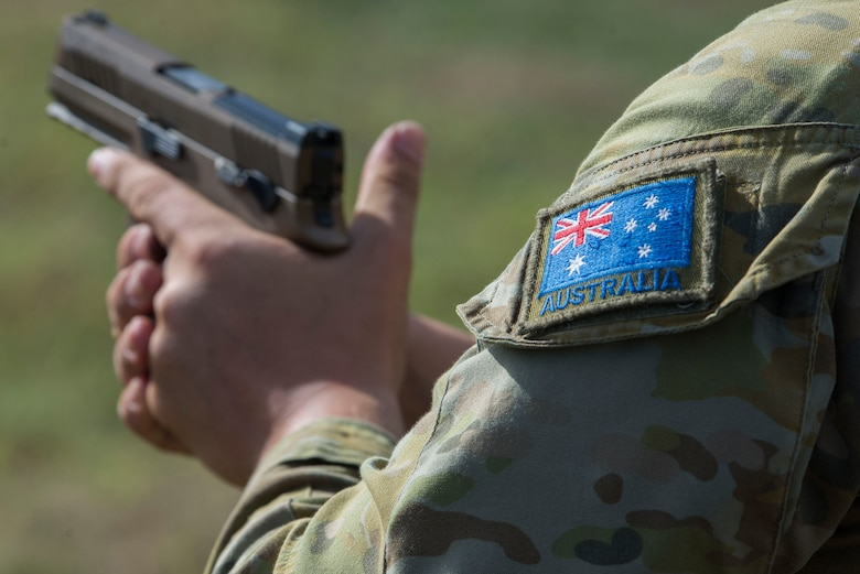 A member of the Royal Australian Air Force (RAAF) prepares to shoot a U.S. Air Force M18 pistol during Pacific Defender 20-1 at Andersen Air Force Base, Guam, Feb. 12, 2020.