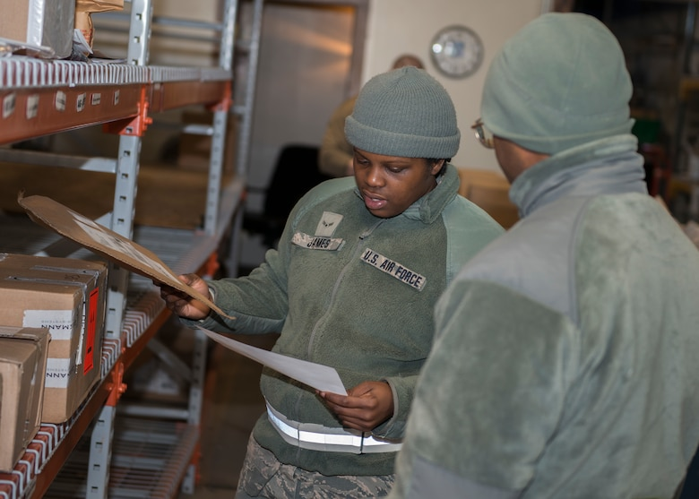 Airman 1st Class Zainab James (left) and Airman Basic Andre Minnis, 103rd Logistics Readiness Squadron ground transportation specialists, prepare deliveries to organizations at Bradley Air National Guard Base, East Granby, Conn. Feb. 8, 2020. The Traffic Management Office delivers incoming equipment to organizations throughout the installation and prepares outgoing shipments. (U.S. Air National Guard photo by Staff Sgt. Steven Tucker)