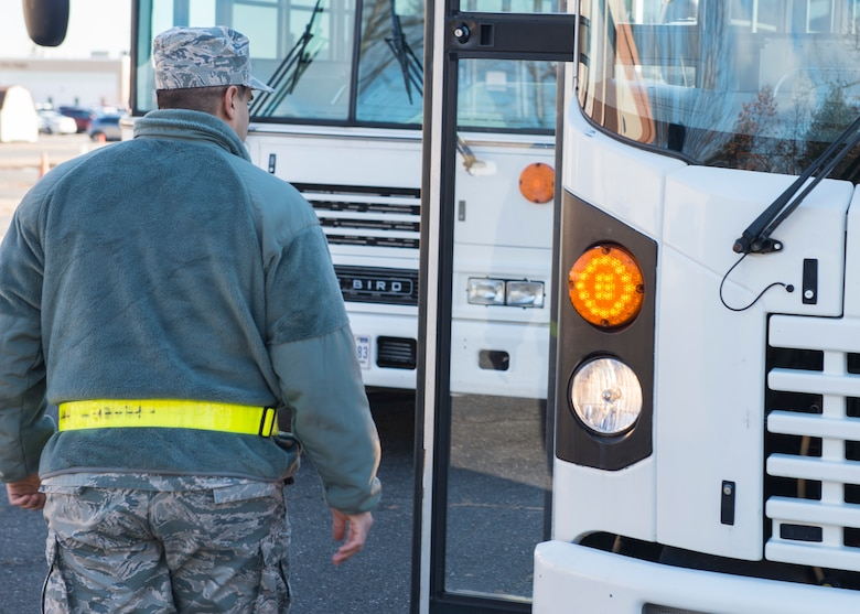 Tech. Sgt. Alexis Carrero, 103rd Logistics Readiness Squadron ground transportation specialist, performs an inspection on a bus at Bradley Air National Guard Base, East Granby, Conn. Feb. 8, 2020. Ground transportation specialists transport people and supplies and train other Airmen to safely operate various types of government vehicles. (U.S. Air National Guard photo by Staff Sgt. Steven Tucker)