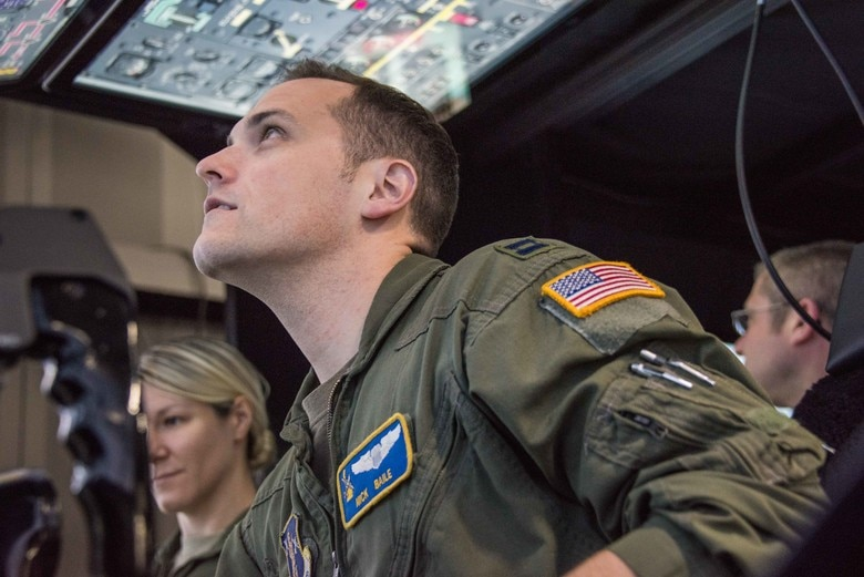 U.S. Air Force Capt. Nicholas Baile, 166th Operations Group pilot, Delaware Air National Guard, troubleshoots a start malfunction in the 166th Airlift Wing flight simulator while Capt. Alexandria Anzur, navigator, sits in the copilot's seat. In the simulator at New Castle Air National Guard Base, flight crews can try every position: pilot, copilot, flight engineer and navigator, leading to a greater understanding of other crew members' responsibilities.