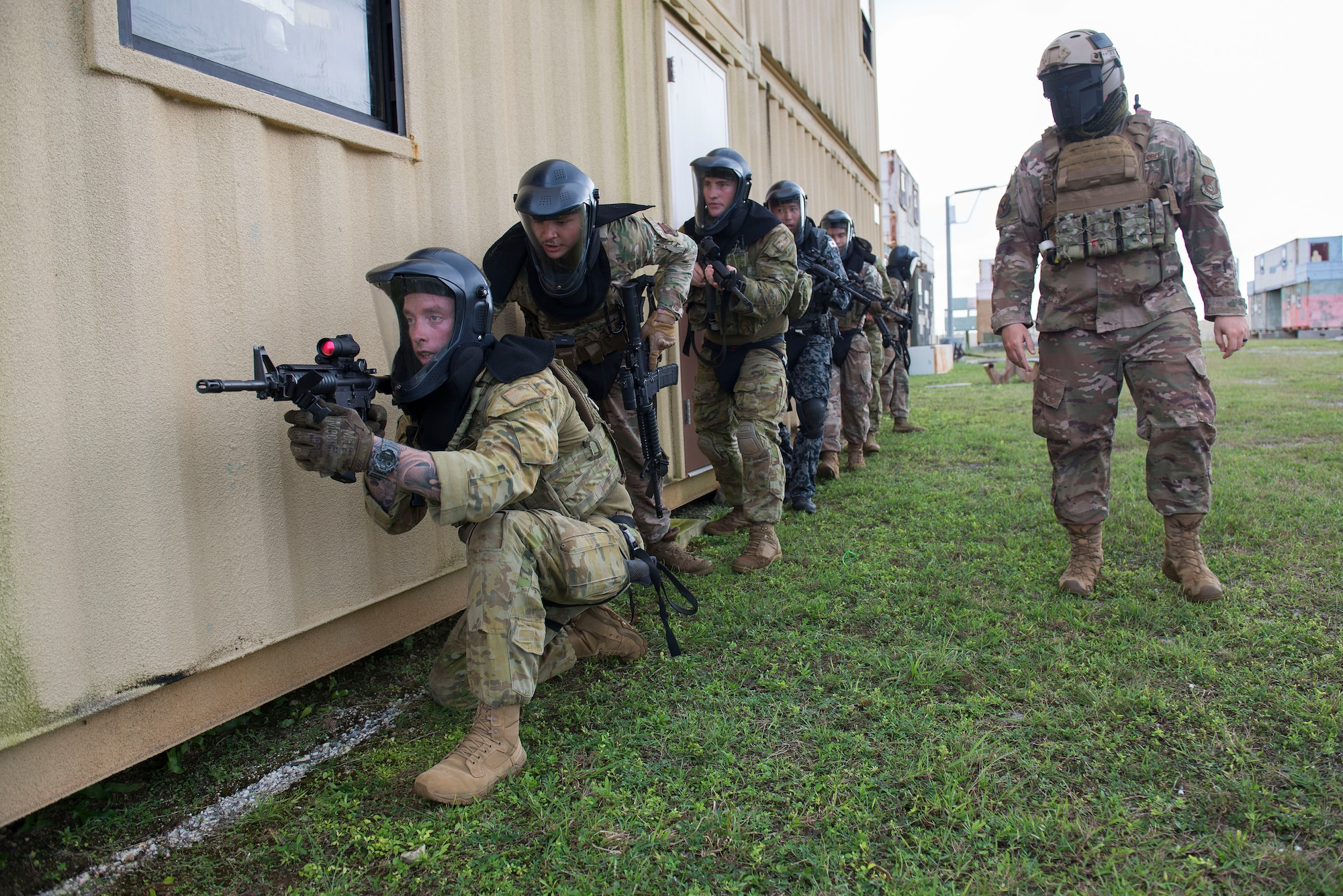 Members of the Royal Australian Air Force, U.S. Air Force, and Koku Jieitai (Japan Air Self-Defense Force) participate in a simulated live fire scenario during Pacific Defender 20-1 at the Pacific Regional Training Center near Andersen Air Force Base, Guam, Feb. 11, 2020.