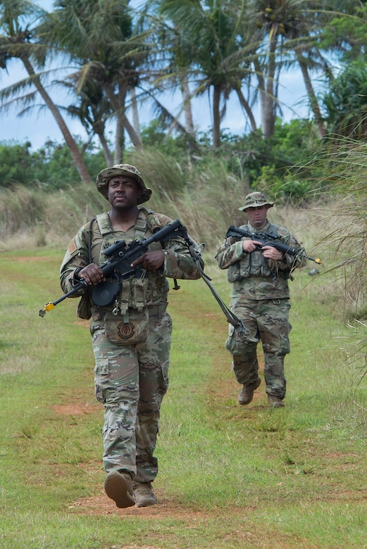 U.S. Air Force Tech. Sgt. Rowdy Spears, 736th Security Forces Squadron noncommissioned officer in charge of standards and evaluations, approaches a training scenario during Pacific Defender 20-1 at the Pacific Regional Training Center near Andersen Air Force Base, Guam, Feb. 10, 2020.