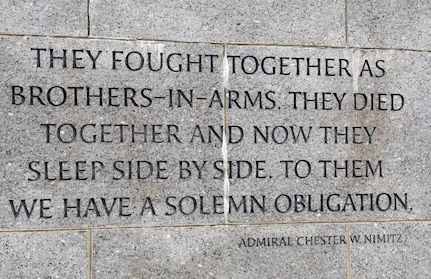 Inscription on stone wall of memorial.