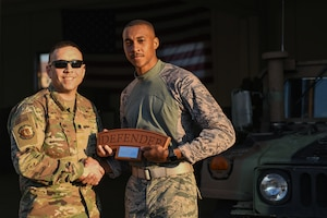 U.S. Air Force Lt. Col. Jesse Goens, 31st Security Forces Squadron commander, presents Aviano's 2020 Defender Challenge award to U.S. Air Force Airman 1st Class Marcus Lafleur, 31st SFS member at Aviano Air Base, Italy, Feb. 14, 2020. Lafleur won third place. (U.S. Air Force photo by Airman 1st Class Ericka A. Woolever)