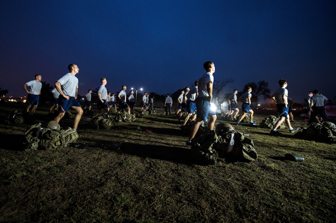 Special warfare trainees conducting physical training early in the morning in darkness