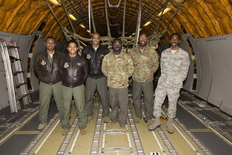 Airmen assigned to Joint Base McGuire-Dix-Lakehurst, New Jersey, pose for a photo on a KC-10 Extender after a Black History Month heritage air-refueling flight on Joint Base MDL. The KC-10, assigned to the 305th Air Mobility Wing, was piloted by an all-African-American crew; two pilots, one from the 514th Air Mobility Wing and one from the 305th AMW, a 32nd Air Refueling Squadron boom operator, one 2nd Air Refueling Squadron flight engineer and 605th Aircraft Maintenance Squadron crew chief. (U.S. Air Force photo by Senior Airman Ariel Owings)