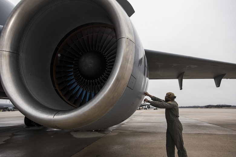 U.S. Air Force Staff Sgt. Demetrius Thornton, 605th Aircraft Maintenance Squadron primary flying crew chief, checks the engine of a KC-10 Extender in preparation for a Black History Month heritage air-refueling flight on Joint Base McGuire-Dix-Lakehurst, New Jersey, Feb. 13, 2020. Thornton explained that while organizing the flight to give recognition to his Wing and honor BHM, he realized how few African-American aircrew members there are. (U.S. Air Force photo by Senior Airman Ariel Owings)