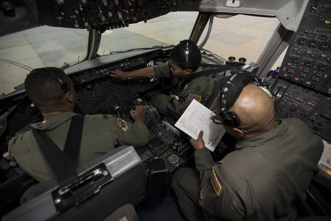 U.S. Air Force Col. Adrian Byers, 514th Air Mobility Wing vice commander, U.S. Air Force Maj. Lynn Grady, 305th Air Mobility Wing command executive, and Senior Master Sgt. Brian Pettaway, 2nd Air Refueling Squadron flight engineer, conduct flight control pre-checks before a Black History Month heritage air-refueling flight on Joint Base McGuire-Dix-Lakehurst, New Jersey, Feb. 13, 2020. Byers believes when military installations are able to put heritage flights together, it brings a sense of pride and remembrance of the legacy they came from. (U.S. Air Force photo by Senior Airman Ariel Owings)